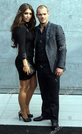 Dutch Midfielder Wesley Sneijder (r) and His Wife Yolanthe Cabau Van Kasbergen Pose For a Photo As They Arrive at Italian Designer Giorgio Armani's Presentation of His Spring-summer 2011 Women's Collection in Milan Italy 27 September 2010 the Milano Moda Donna Fashion Week Runs From 22 to 28 September Italy Milano