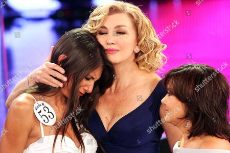 Italian Presenter Milly Carlucci (c) and Patroness Patrizia Mirigliani (r) Comfort Contestant Alessia Mancini (l) As Italian Press Accused Her to Be a Transsexual During the Second Evening of the 71st Miss Italy Beauty Pageant in Salsomaggiore Terme Italy 12 September 2010 the Finals of the Beauty Pageant Held in Salsomaggiore Terme Run Until 13 September Italy Salsomaggiore Terme