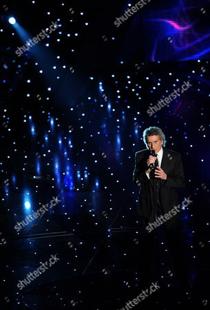 Stock Photo of Italian Singer Toto Cutugno Performs During the First Evening of the 2010 Sanremo Italian Song Festival at the Ariston Theatre in Sanremo Italy 16 February 2010 the Festival Runs Until 20 February Italy Sanremo