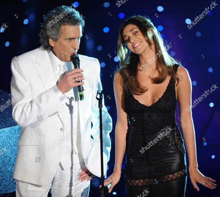 Singer Belen Rodriguez Onstage with Duet Partner Toto Cutugno (l) During the Third Evening of the 2010 Sanremo Italian Song Festival at the Ariston Theatre in Sanremo Italy 18 February 2010 the Festival Runs Until 20 February Italy Sanremo