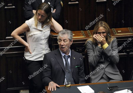 Italian Reforms Minister Umberto Bossi (c) Italian Youth Minister Giorgia Meloni (l) and Italian Environment Minister Stefania Prestigiacomo (r) Are Seen During the Voting to Reject a No-confidence Motion Against a Junior Minister of Italian Prime Minister Silvio Berlusconi's Government at Italy's Chamber of Deputies in Rome Italy 04 August 2010 Berlusconi's Opponents Wanted to Force the Resignation of Junior Justice Minister Giacomo Caliendo who is Under Police Investigation For Alleged Influence-peddling -- the Sort of Morality and Legality Issue Which Led Fini to Pull His Supporters out of Government Italy Rome
