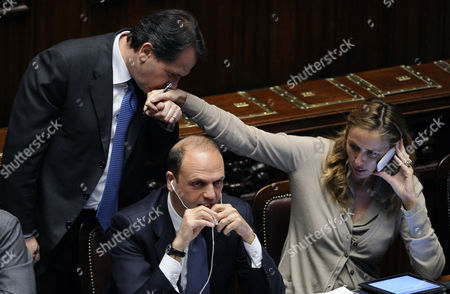 Italian Agriculture Minister Francesco Saverio Romano (l) Kisses the Hand of Environment Minister Stefania Prestigiacomo During a Parliament Session in Rome Italy 12 April 2011 Italy Rome