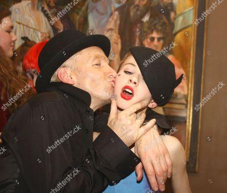 Robert Newmark kissing a friend.