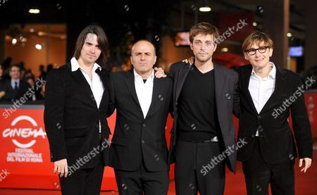 Film Director Ilan Duran Cohen (2-l) Poses For Photographers with Actors Guillaume Quatravaux (l) Julien Baumgartner (2-r) and Lorant Deutsch (r) on the Red Carpet Prior to the Sreening of Their Film 'Le Plaisir De Chanter' at the 3rd Rome Film Festival 28 October 2008 in Rome Italy the Festival Runs Until 31 October 2008 Italy Rome