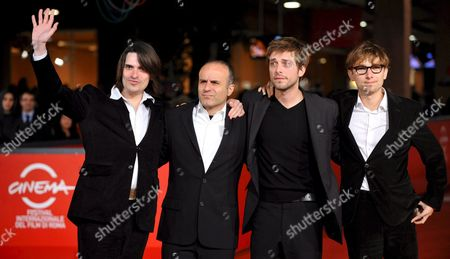 Stock Picture of Film Director Ilan Duran Cohen (2-l) Poses For Photographers with Actors Guillaume Quatravaux (l) Julien Baumgartner (2-r) and Lorant Deutsch (r) on the Red Carpet Prior to the Sreening of Their Film 'Le Plaisir De Chanter' at the 3rd Rome Film Festival 28 October 2008 in Rome Italy the Festival Runs Until 31 October 2008 Italy Rome