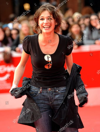 Stock Photo of Romanian Actress Ana Caterina Morariu Poses on the Red Carpet As She Arrives at the Screening of the Film 'The Twilight Saga: New Moon' by Us Movie Director Chris Weitz Presented out of Competition at the 4th Rome International Film Festival Italy on 22 October 2009 Italy Rome