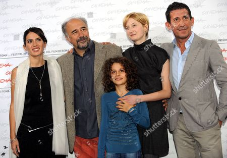 Stock Picture of Italian Director Giorgio Diritti (2-l) Poses For Photographs with Italian Actors and Cast Members (l-r) Maya Sansa Greta Zuccheri Montanari Alba Rohrwacher and Claudio Casadio As They Attend the Photocall of the Movie 'L'uomo Che Verra' During the 4th Annual Rome Film Festival in Rome Italy 21 October 2009 the Movie Directed by Giorgio Diritti is Presented in the Official Competition of the Festival Running Until 23 October Italy Rome