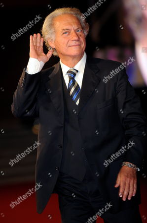 Actor Giorgio Colangeli Poses on the Red Carpet Before the Screening of the Film 'Raise Your Head' Directed by Alessandro Angelini During the Fourth Annual Rome Film Festival in Rome Italy 18 October 2009 Italy Rome