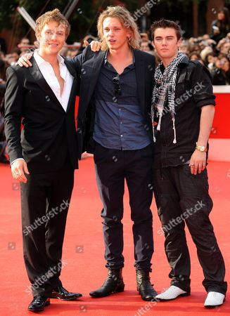 Canadian Actor Cameron Bright (r) Poses on the Red Carpet with British Actors Charlie Bewley (l) and Jamie Campbell Bower (c) As They Arrive at the Screening of the Film 'The Twilight Saga: New Moon' by Us Movie Director Chris Weitz Presented out of Competition at the 4th Rome International Film Festival Italy on 22 October 2009 Italy Rome