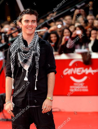 Canadian Actor Cameron Bright Poses on the Red Carpet As He Arrives at the Screening of the Film 'The Twilight Saga: New Moon' by Us Movie Director Chris Weitz Presented out of Competition at the 4th Rome International Film Festival Italy on 22 October 2009 Italy Rome
