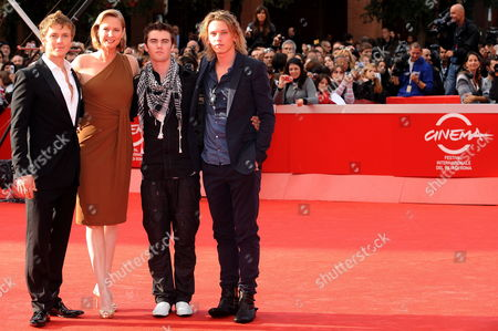 Us Scriptwriter Melissa Rosenberg (2l) Poses with Canadian Actor Cameron Bright (2r) and British Actors Charlie Bewley (l) and Jamie Campbell Bower (r) on the Red Carpet As They Arrive at the Screening of the Film 'The Twilight Saga: New Moon' by Us Movie Director Chris Weitz Presented out of Competition at the 4th Rome International Film Festival Italy on 22 October 2009 Italy Rome