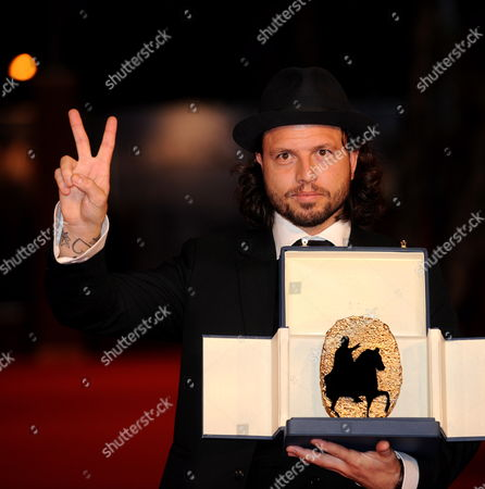 Danish Film Director Nicolo Donato Poses For a Photo on the Red Carpet with His Gold Marc'aurelio Best Film Award For the Film 'Brotherskab (brotherhood)' During the 4th Annual Rome Film Festival in Rome Italy 23 October 2009 the Film is About Two Men who Become Lovers After Joining a Gang of Neo-nazis Italy Rome