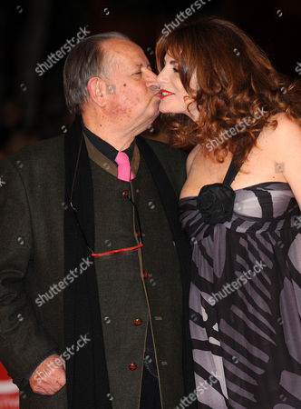 Italian Movie Director Tinto Brass (l) and Actress Caterina Varzi Pose on the Red Carpet As They Arrive at the Screening of the Film 'Christine' by Compatriot Actress and Movie Director Stefania Sandrelli Presented out of Competition at the 4th Rome International Film Festival Italy on 19 October 2009 Italy Rome