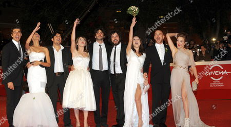 From Left: Luca Argentero and Moran Atias Dario Bandiera and Isabella Ragonese Italian Director Luca Lucini Francesco Montanari and Gabriella Pession Filippo Nigro and Carolina Crescentini Pose on the Red Carpet As They Arrive at the Screening of the Film 'Oggi Sposi' Directed by Luca Lucini Presented out of Competition at the 4th Rome International Film Festival Italy on 20 October 2009 Italy Rome