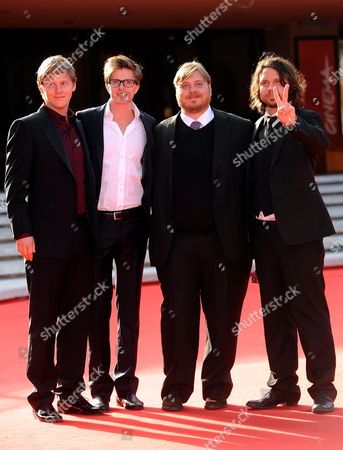 From Left: Thure Lindhardt Mortens Holst Nicolas Bro and Nicolo Donato (director) Pose on the Red Carpet Prior to the Screening of the Film 'Brotherskab' at the Fourth Rome International Film Festival 21 October 2009 in Rome Italy the Movie by Danish Director Nicolo Donato is Presented in Competition at the Festival Running Until 23 October Italy Rome