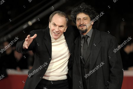 A Picture Dated 18 October 2009 Shows Romanian Director Radu Mihaileanu (r) and Actor Aleksei Guskov (l) Posing on the Red Carpet Prior to the Premiere of Their Film 'Le Concert' at the Fourth Rome International Film Festival in Rome Italy the Movie is Presented out of Competition of the Festival Running From 15 to 23 October Italy Rome
