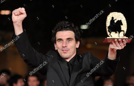 French Director Olias Barco Poses with Marc'aurelio Jury Award For Best Film For His Movie 'Kill Me Please' During the Awards Ceremony of the 5th Rome Film Festival in Rome Italy 05 November 2010 Italy Rome