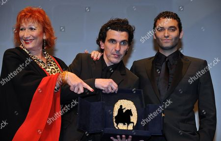 Stock Photo of French Director Olias Barco (c) Poses with French Actors Zazie De Paris (l) and Virgile Bramly (r) After They Received the Marc'aurelio Jury Award For Best Film For Their Movie 'Kill Me Please' During the Awards Ceremony of the 5th Rome Film Festival in Rome Italy 05 November 2010 Italy Rome