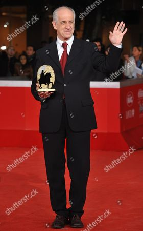 Italian Actor Toni Servillo Poses with the Marc'aurelio Jury Award For Best Actor at the Awards Ceremony of the 5th Rome Film Festival in Rome Italy 05 November 2010 Servillo Received the Award For His Role in the Movie 'Una Vita Tranquilla' (a Quiet Life) by Italian Director Claudio Cupellini Italy Rome
