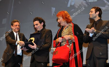 Italian Actor and Jury President Sergio Castellitto (l) Hands Over the Marc'aurelio Jury Award For Best Film to French Director Olias Barco (2-l) and French Actors Zazie De Paris (2-r) and Virgile Bramly (r) For Their Movie 'Kill Me Please' During the Awards Ceremony of the 5th Rome Film Festival in Rome Italy 05 November 2010 Italy Rome