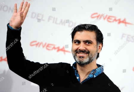 Stock Photo of Iranian-american Director Hossein Keshavarz Poses During the Photocall For His Movie 'Dog Sweat' at the 5th Annual Rome Film Festival in Rome Italy 29 October 2010 the Movie is Presented in the Official Competition of the Festival That Runs From 28 October to 05 November Italy Rome