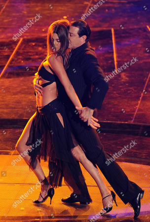 Stock Photo of A Picture Made Available on 16 February 2011 Shows Argentinean Tv Personality Belen Rodriguez (l) As She Dances with Argentinean Dancer Miguel Angel Zotto During the 61st Sanremo Italian Song Festival at the Ariston Theater in Sanremo Italy 15 February 2011 the Festival Runs From 15 Until 19 February 2011 Italy Sanremo