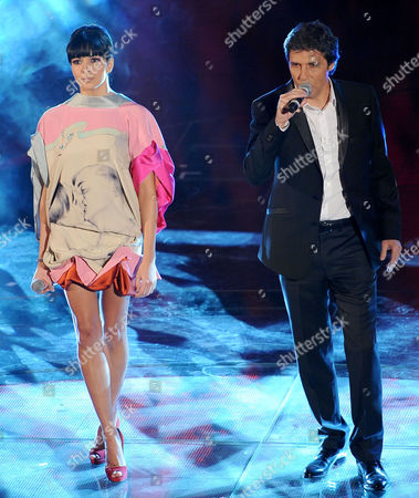 Singers Luca Barbarossa (r) and Raquel Del Rosario (l) Perform on Stage During the 61st Sanremo Italian Song Festival at the Ariston Theater in Sanremo Italy 19 February 2011 the Festival Runs From 15 To19 February Italy Sanremo