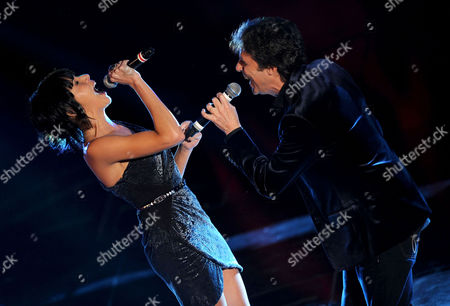 Italian Singer Luca Barbarossa (r) and Spanish Singer Raquel Del Rosario Perform Onstage During the 61st Sanremo Italian Song Festival at the Ariston Theater in Sanremo Italy 15 February 2011 the Festival Takes Place From 15 to 19 February Italy Sanremo