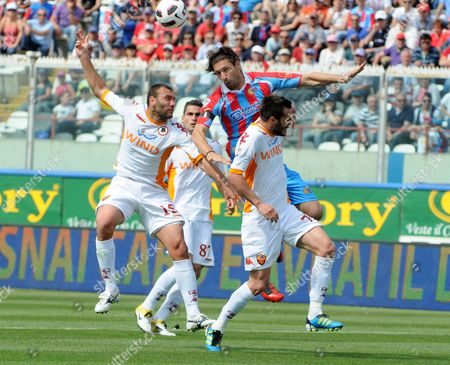 Catania's Italian Defender Christian Terlizzi (center) Surrounded by Roma's Defenders Simone Loria (left) Marco Cassetti (right) and Aleandro Rosi (back) During the Italian Serie a Soccer Match Catania-roma Today 14 May 2011 at Angelo Massimino Stadium in Catania Italy Catania