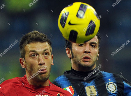 Inter Milan Forward Gianpaolo Pazzini (r) Struggles For the Ball with Cagliari Michele Canini During Their Serie a Soccer Match at the Giuseppe Meazza Stadium in Milan Italy 19 February 2011 Italy Milan