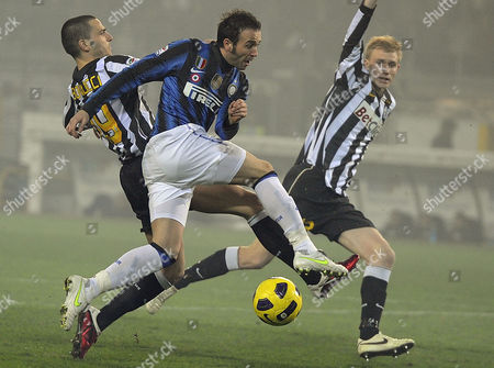 Inter Milan Forward Gianpaolo Pazzini (c) Struggles For the Ball with Juventus Defender Leonardo Bonucci (l) and Teammate Frederik Sorenson During Their Italian Serie a Soccer Match in Turin Olympic Stadium Italy 13 February 2011 Italy Turin