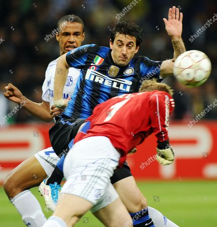 Fc Shalke 04 Goalkeeper Manuel Neuer (front) Vies with Inter Milan Argentinian Forward Diego Alberto Milito (c) As Fcc Shalke 04 Ghanaian Defender Hans Sarpei (back) Looks on During the First Leg Uefa Champions League Quater-final Match Between Inter Milan and Schalke 04 at the San Siro Stadium in Milan Northen Italy 05 April 2011 Italy Milan