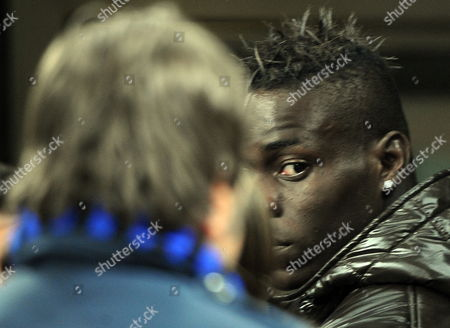 Teenage Striker Mario Balotelli of Internazionale Fc Milano Attends the Match As a Spectator After He Has Been Left out Again After Falling out with Coach Jose Mourinho During the Champions League First Round Quarter Final Soccer Match Internazionale Fc Milano Vs Cska Moscow in Milan's Giuseppe Meazza Stadium 31 March 2010 Italy Milan