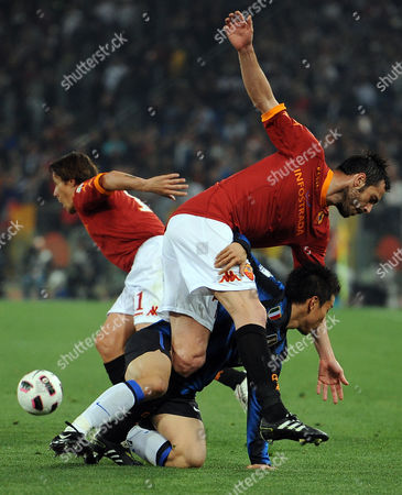 Marco Cassetti (up) of As Roma and Yuto Nagatomo of Inter Milan in Action During Their Italian Soccer Cup First Leg Semi Final Match at Olimpico Stadium in Rome Italy on 19 April 2011 Italy Rome