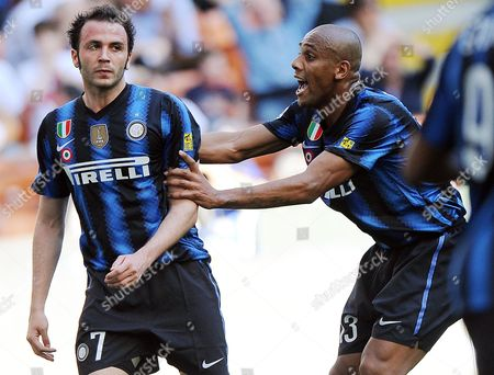 Inter Milan Forward Gianpaolo Pazzini (l) Shows His Disappointment After Missing a Goal Chance As Inter Milan Brazilian Defender Sisenando Maicon Douglas Cheers Him Up During a Serie a Match Between Inter Milan and Ac Chievo Verona at the San Siro Stadium in Milan Northen Italy 09 April 2011 Italy Milan