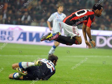 Ac Milan's Brazilian Forward Robinho (r) Jumps Over Sampdoria Genoa's Italian Goalkeeper Gianluca Curci (l) During Their Italian Serie a Soccer Match at San Siro Stadium in Milan Northen Italy 16 April 2011 Milan Won 3-0 Italy Milan
