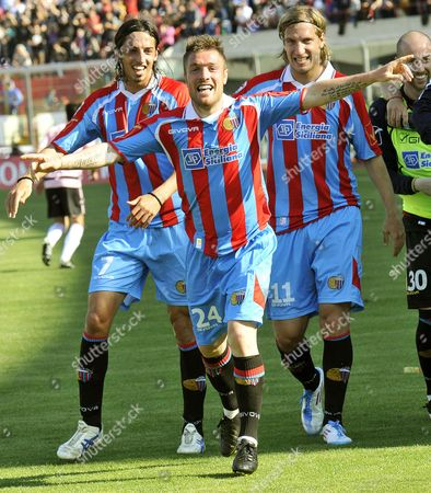 Catania Calcio Midfielder Simone Pesce (c) Celebrates with His Argentinian Team Mates Matias Ezequiel Schelotto (l) and Maxi Lopez (r) After Scoring the 4-0 Lead Against Us Palermo During Their Italian Serie a Sicily Derby Soccer Match at Angelo Massimino Stadium in Catania Italy 03 April 2011 Catania Won 4-0 Italy Catania