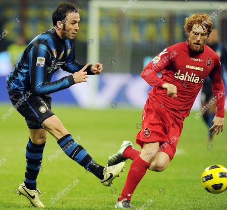 Inter Milan Forward Gianpaolo Pazzini (l) Struggles For the Ball with Cagliari Davidi Biondini (r) During Their Serie a Soccer Match at the Giuseppe Meazza Stadium in Milan Italy 19 February 2011 Italy Milan