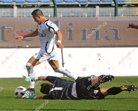 Alexis Sanchez (l) of Udinese Calcio Scores the 2-0 Lead Against Cagliari Calcio Goalkeeper Michael Agazzi (r) During Their Italian Serie a Soccer Match in Cagliari Sardinia Island Italy 13 March 2011 Udinese Won 4-0 Italy Cagliari
