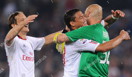 Ac Milan Players Massimo Ambosini (l) Thiago Silva (c) and Goalkeeper Cristian Abbiati (r) Celebrate After Their Italian Serie a Soccer Match Against As Roma at the Olympic Stadium in Rome Italy 07 May 2011 Ac Milan Clinched Its First Serie a Title Since 2004 with a 0-0 Draw at Roma Italy Rome