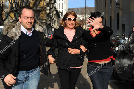 Nadia Macri (c) is Escorted by Plainclothes Police Officers For Questioning with Prosecutors on 21 January 2011 in Milan Italy 27-year-old Nadia Macri a Self-described Escort who Claims to Have Received Money From Berlusconi in Exchange For Sex Began Giving Testimony Before Prosecutors Macri Also Claims to Have Spotted Then 17-year-old Karima El Mahroug at the Centre of Underage Prostitution Charges Against the 74-year-old Premier at Italian Premier Berlusconi's Arcore Residence on April 24 Italy Milan