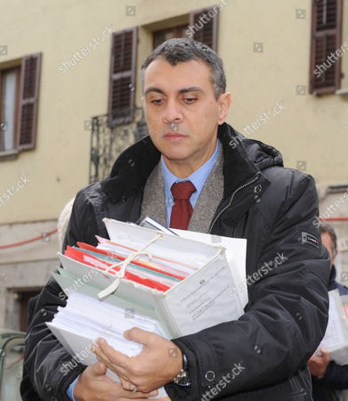 Judge Gianfranco Colace Carries Documents As He Arrives For the Olympic Games 2006 Doping Trial of Ten Members of the Austrian Ski Federation at Susa Court in Turin Italy on 14 December 2009 Among the Accused Are Current President of the Austrian Ski Federation Peter Schroecksnadel Men's Biathlon Head Coach Markus Gandler Ex-country and Biathlon Coach Walter Mayer Former Biathletes Wolfgang Rottmann and Wolfgang Perner and Former Cross-country Skiers Martin Tauber Johannes Eder and Jurgen Pinter the Trial That Started in October 2009 and Resumed on 14 December 2009 was Postponed After a Couple of Minutes As the Austrian Ski Federation Reportedly Rejected the English Translator Due to Insufficient Linguistic Proficiency the Trial is Scheduled to Continue on 02 March 2010 Italy Torino