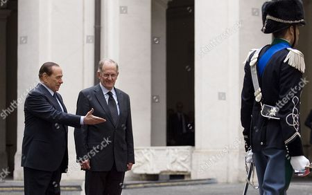 Italian Prime Minister Silvio Berlusconi (l) and Joseph Deiss (2-l) the President of the United Nations General Assembly For Its 65th Session in 2010 During the Guard of Honor 17 May 2011 at Palazzo Chigi in Rome Deiss is on an Official Visit to Rome Italy Rome