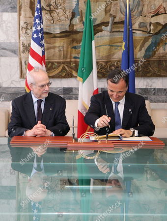 Stock Photo of The President of American Revolution Center Bruce Cole (l) and Italian Foreign Minister Franco Frattini Sign Documents During a Ceremony at the Foreign Ministry in Rome Italy on 16 June 2011 They Were Signing a Declaration of Intent For the Opening of a Section Devoted to Relations Between Italy and the Founding Fathers of the United States at the New Museum of the American Revolution That Will Be Created in Philadelphia the Section Will Also Focus on Relations Between the Countries in the Period of Italian Unification the Declaration of Intent was Also Signed by Culture Minister Giancarlo Galan (unseen) Italy Rome
