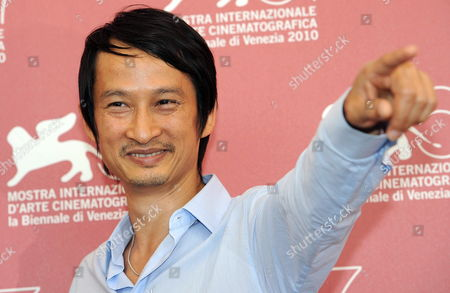 Vietnamese-french Director Anh Hung Tran Poses During the Photocall For the Movie 'Noruwei No Mori' (norwegian Wood) at the 67th Annual Venice Film Festival in Venice Italy 02 September 2010 the Movie is Presented in the International Competition 'Venezia 67' at the Festival Running From 01 to 11 September 2010 Italy Venice