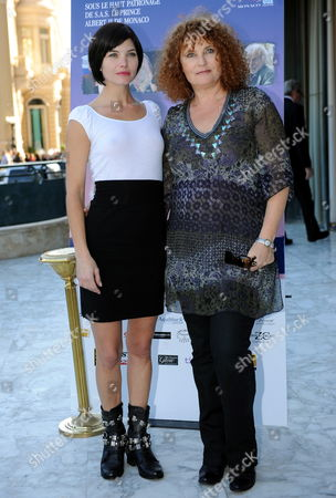 French Actresses and Jury Members Delphine Chaneac (l) and Valerie Mairesse Pose in Front of the Casino in Monte Carlo Monaco 28 November 2009 Prior to the Press Conference to Announce the Winners of the Ninth Monte-carlo Film Festival De La Comedie the Festival Runs Until 28 November Monaco Monte-carlo