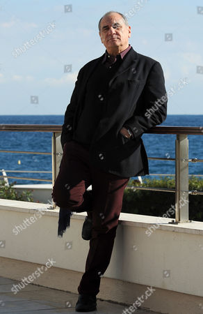 Stock Image of Italian Screenwriter Vincenzo Cerami the Chairman of the Jury of the 10th Edition of the Monte Carlo Festival De La Comedie Poses For a Photograph in Front of Monte Carlo's Grimaldi Forum Monaco November 26 2010 Cerami is Writing a Film About Vulgarity Cynicism Misogyny and the Other Problematic Ideological Trends of Our Times Monaco Montecarlo