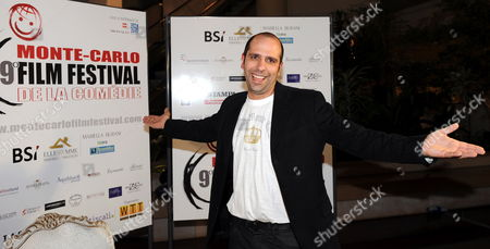 Italian Singer and Actor/cast Member Checco Zalone Poses For a Photo As He Arrives For the Screening of His Film 'Cado Dalle Nubi' ('i Fall From the Clouds' an Italian Expression Meaning 'I Am Astounded') by Compatriot Movie Director Gennaro Nunziante Presented at the 9th Monte Carlo Film Festival De La Comedie in Monte Carlo in the Principality of Monaco on 26 November 2009 Monaco Monte Carlo