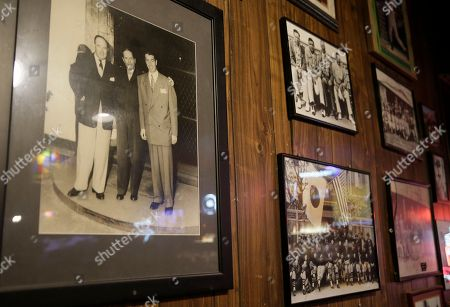 Stock Photo of Shows a photograph, left, taken in Japan of Lefty O'Doul, Gen. Douglas MacArthur and Joe DiMaggio hanging at Lefty O'Doul's restaurant and lounge in San Francisco. The historic baseball memorabilia and piano bar beloved by locals and tourists is set to close this week after its lease expires. Lefty O'Doul's may return to downtown Union Square, but it's unclear who will be in charge as the bar's longtime operator and building owner are fighting over ownership. The establishment's final day is Wednesday, Feb. 1