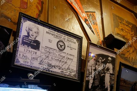 Shows an enlarged military identification card for Marilyn Monroe, when she was the wife of Joe DiMaggio, hanging at Lefty O'Doul's restaurant and lounge in San Francisco. The historic sports bar and hofbrau, filled with baseball memorabilia, is set to close because of a landlord dispute in February. The restaurant opened in 1958 and is seeking a new home